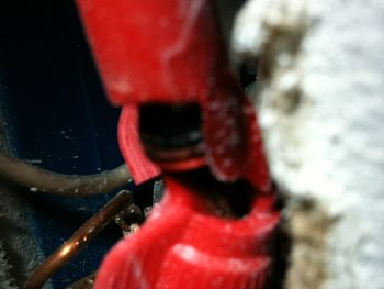 Melted wire nut. photo of red wire nut melted.